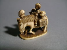 Ivory Netsuke - group and horse - Japan - end of the 19th century (Meiji era)