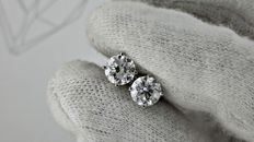 1.40 ct  D/VS2  round diamond stud earrings 14 kt white gold