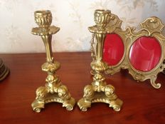 Old golden bronze candlestick pair and bronze picture frame