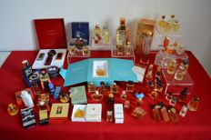 70 bottles from the large French perfumeries: 15 boxes or cabinets - 15 Guerlain, 7 Givenchy, 10 YSL, 11 Nina Ricci, signed sprays etc