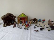 Three wooden Christmas stalls and Flat wooden Christmas figurines including some of Eskimos