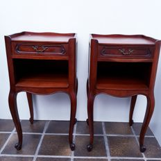 A pair of nutwood chevets, bedside tables