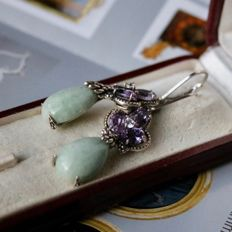 Antique Sterling silver hanging earrings with faceted oval cut Amethyst 5x4mm each totalling 0,75 Ct.
