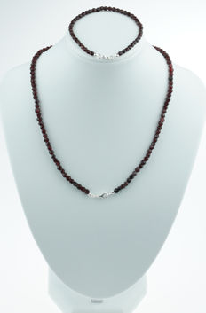 Set of a necklace and bracelet with garnets and silver clasps - regional item of jewellery
