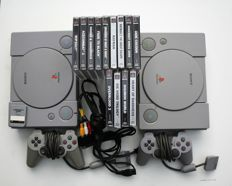 2 Playstation 1 consoles with controllers and 13 games eg rayman 1 and 2, heart of darkness and more