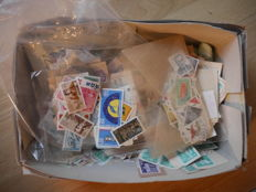 GDR - postal items - in bags, extract sheets, loose stamps, stamp album, pieces of letters in a carton