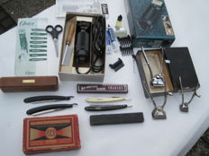 Three hair clippers, four antique razors and an Oster shaver