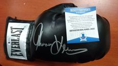 Boxing glove Everlast black color signed by Thomas Hearns with certificate of authenticity Beckett