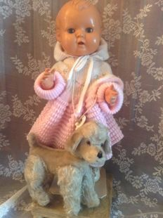 Very large Kader doll along with an antique Hermann/Steiff dog