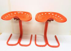 Unknown manufacturer - two vintage 'Tractor' stools
