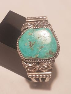 Solid Navajo bracelet inlaid with turquoise handiwork by a native American master, signed PTG