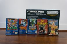 Nice boxed NES with 5 games.