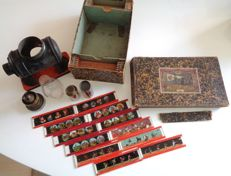 Plank, Germany - Length 14 cm - Tin magic lantern with pictures, early 20th century