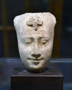 An Egyptian painted limestone head of a Pharaoh - 4 inches high