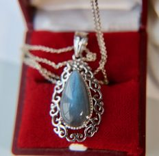 Vintage Sterling silver pendant with a darkening blue Labradorite on a silver necklace.
