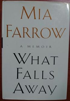 "Book ""What Falls Away"" of the 1997 of Mia Farrow with its signature in the interior"