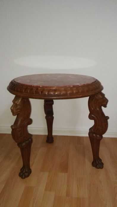 A wooden side table with lions carved on legs and red marble tabletop, second half of the 20th century