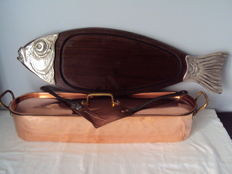 Copper fish kettle, stainless steel interior and accompanying two copper utensils 1970/1980 and a lovely serving board