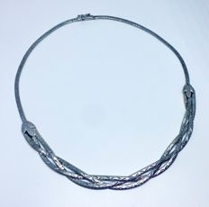 Beautiful widely braided silver necklace.