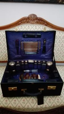 Dressing table set, silver, crystal and tortoise shell. France 19th century, leather bag included