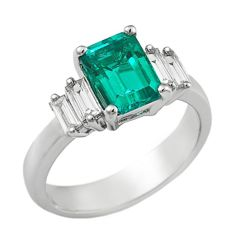 18 kt white gold ring with emeralds 1.51 ct and diamonds for 0.38 ct