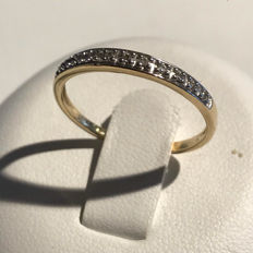 14 kt gold women's ring with 11 diamonds