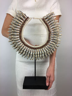 Shell necklace on a stand • Indonesia