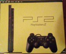 Playstation 2 in box with 12 games multitap for 4 players, odin sphere sealed.