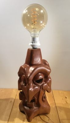 Wooden lamp with a different hand-carved mask on every corner