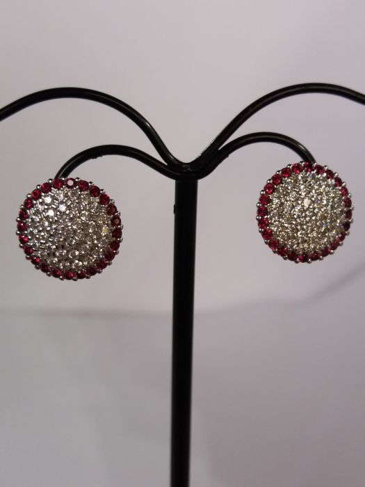 Round earrings with brilliant cut red and white zircons in pavé setting