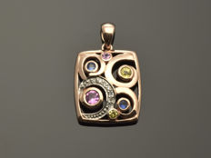 Gold 14 kt pendant with diamonds, sapphires and tourmalines. Size 17 x 15 mm Weight 2.58 g
