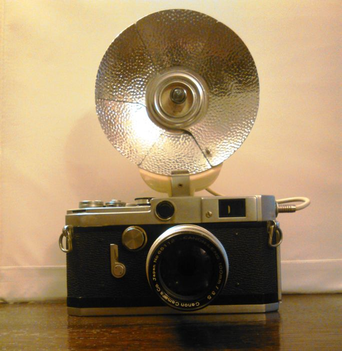 Canon model L-1 with Canon 3,5/100mm lens and flash bulb gun Kobold. Japan 1956