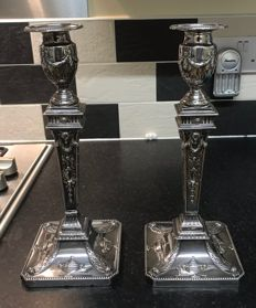 A pair of Edwardian silver candlesticks decorated in a neoclassical style - T.A.S - Sheffield - 1906