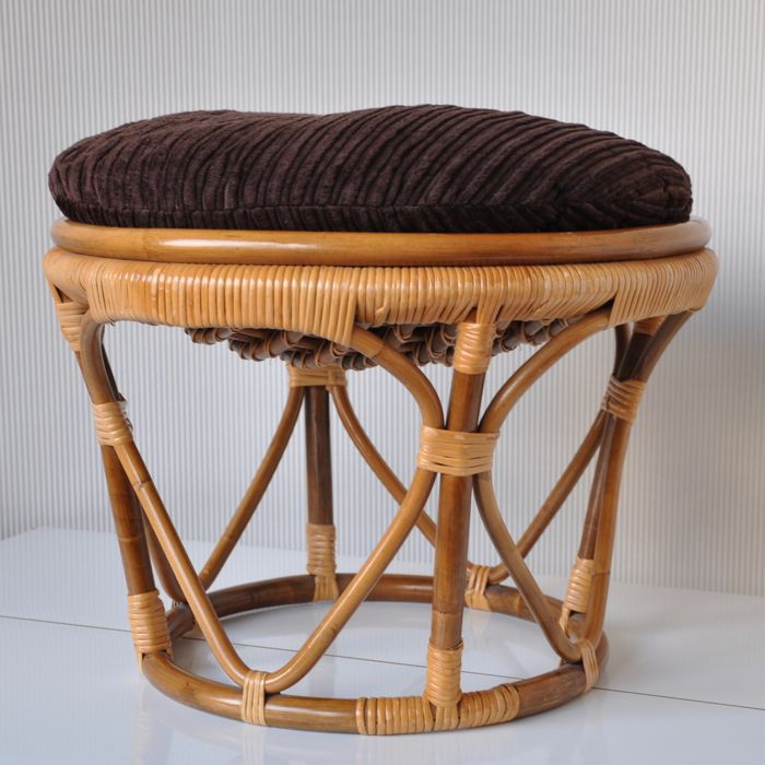 Manufacturer unknown - vintage mid-century rattan footstool with original cushion.
