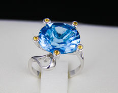 10.35 ct. Swiss Blue Topaz And Sapphires Gold Ring.