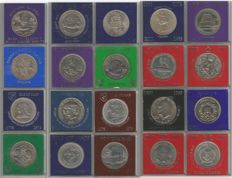 World - Various crown-size coins in Sandhill cases (20 pieces)