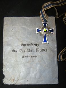 Silver Mother Cross in the original pouch