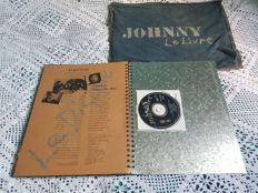 """Johnny Hallyday : """"Livre métal"""". including Jeans bag, cd and book with metal front by Johnny Hallyday"""