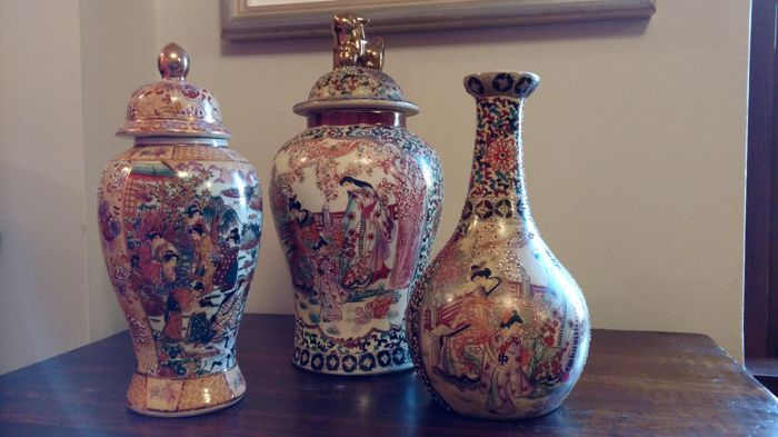 Three oriental vases in polychrome porcelain - China, late 20th Century
