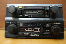 Two classic Stereo car radios with cassette from the 1970s and 1980s.