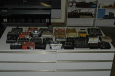 Collection of vintage radio controls for model planes, cars and boats