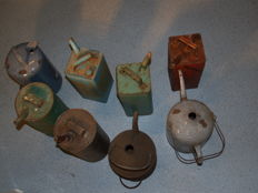 Collection of eight original petroleum jugs from the period 1940-1960