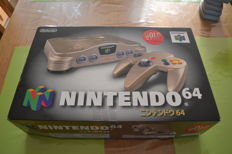 Boxed Limited JPN Nintendo 64 Gold edition with 10 games.