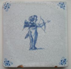 Antique tile depicting cupid with bow and arrow.