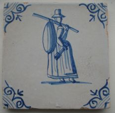 Antique tile with a figure, special image of a carpet-beater