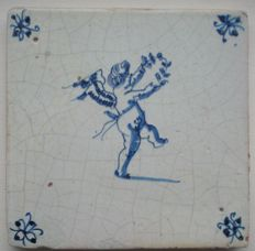 Antique tile with Cupid with a laurel wreath