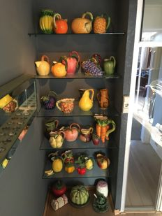 Collection of 33 different earthenware/ceramic fruit jugs