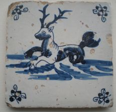 Antique tile with sea creature, corner pattern: ox head. Exceptional scene!