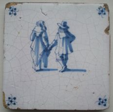 Antique tile with figures