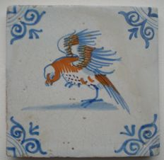 Antique tile with a polychrome bird with parrot (rare version)